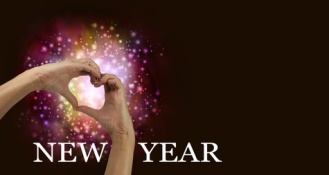 New Year Heart Hands - pair of female hands making heart shape with red orange pink colored sparkles behind on a dark background with copy space and the words NEW YEAR running along the bottom