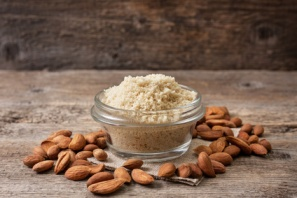 almond flour in a wooden bowl, almonds